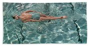 A Woman Swimming In A Pool Bath Towel