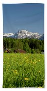A Woman Walks Through An Alpine Meadow Bath Towel