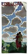 A Young Couple And Their Dogs On A Hilltop Bath Towel