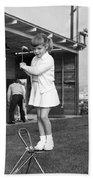 A Young Girl Hits A Golf Ball Bath Towel