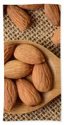 Almonds On A Spoon With Brown Background Bath Towel