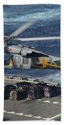 An Mh-60s Sea Hawk Helicopter Picks Bath Towel
