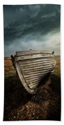 An Old Wreck On The Field. Dramatic Sky In The Background Bath Towel