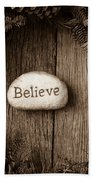 Believe In Text In The Center Of A Christmas Wreath Bath Towel