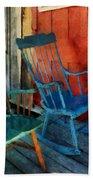 Blue Chair Against Red Door Bath Towel