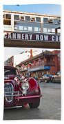 Classic Cannery Row - Monterey California With A Vintage Red Car. Bath Towel