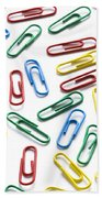 Colorful Paperclips On White Bath Towel