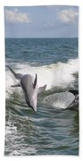 Dolphins At Play Bath Towel