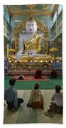faithful Buddhists praying at sitting Buddha in golden Ponnya Shin Pagoda Bath Towel