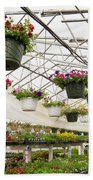 Flowers Growing In Foil Hothouse Of Garden Center Bath Towel