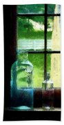 Glass Bottles On Windowsill Bath Towel