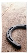 Horseshoe On Wood Floor Bath Towel