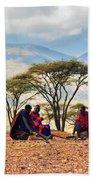 Maasai Men Sitting. Savannah Landscape In Tanzania Bath Towel