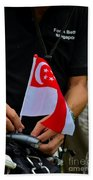 Man Plants Singapore Flag On Bicycle Bath Towel