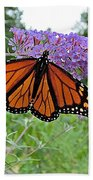Monarch Under Flowers Bath Towel