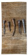 Old Nails On A Wooden Table Bath Towel