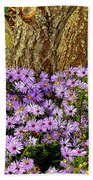 Purple Flowers At Base Of Tree Bath Towel