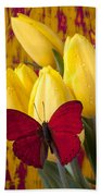 Red Butterfly Resting On Tulips Bath Towel