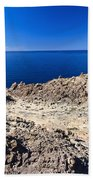 rocky coast in San Pietro island Bath Towel