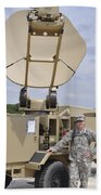 Soldier Stands Next To A Satellite Bath Towel