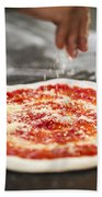 Sprinkling Cheese On Home Made Pizza Bath Towel