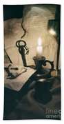 Still Life With Bones Rusty Key Wine Glass Lit Candle And Papers Bath Towel