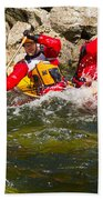 Two Men Paddling A Red Whitewater Canoe Bath Towel