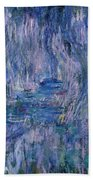 Waterlilies And Reflections Of A Willow Tree Hand Towel by Claude Monet