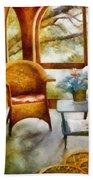 Wicker Chair And Cyclamen Bath Towel