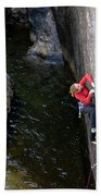 Woman Climbing Above A River Hand Towel