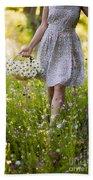 Woman Picking Flowers In A Wild Flower Meadow Bath Towel