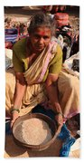 Woman Sifting In A Street Market India Bath Towel