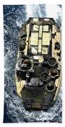 An Amphibious Assault Vehicle Navigates Bath Towel
