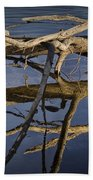 Fallen Tree Trunk With Reflections On The Muskegon River Bath Towel