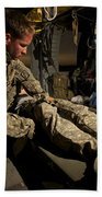 U.s. Army Specialist Practices Giving Bath Towel