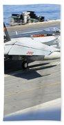 An Fa-18e Super Hornet Lands Aboard Bath Towel