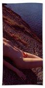 Nude Woman Lying On Rocks By The Water Bath Towel