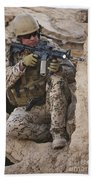 A German Army Soldier Armed With A M4 Hand Towel