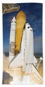 Space Shuttle Atlantis Lifts Bath Towel