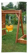 A Childs Playing Equipment In A Green Location Bath Towel