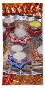 A Decorated Hindu Prayer Thaali With Wax Candles Oil Lamps Bath Towel