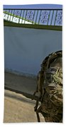 A Soldier Patrols The Streets Of Qalat Bath Towel