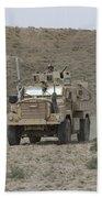 A U.s. Army Cougar Patrols A Wadi Bath Towel