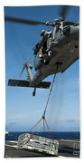 An Mh-60s Sea Hawk Helicopter Lowers Bath Towel