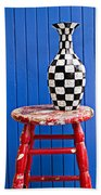 Blach And White Vase On Stool Against Blue Wall Bath Towel