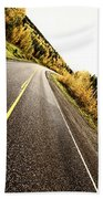 Center Lines Along A Paved Road In Autumn Bath Towel