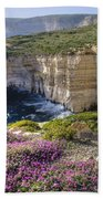 Cliffs Along Ocean With Wildflowers Bath Towel