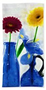 Cobalt Blue Glass Bottles And Gerbera Daisies Bath Towel