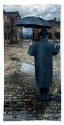 Man In Vintage Clothing With Umbrella On Rainy Brick Street Bath Towel