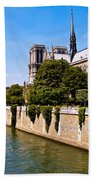 Notre Dame Cathedral Along The Seine River Bath Towel